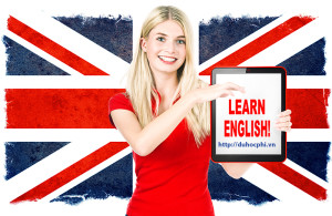 young woman holding tablet pc on the background with british national flag. english learning concept